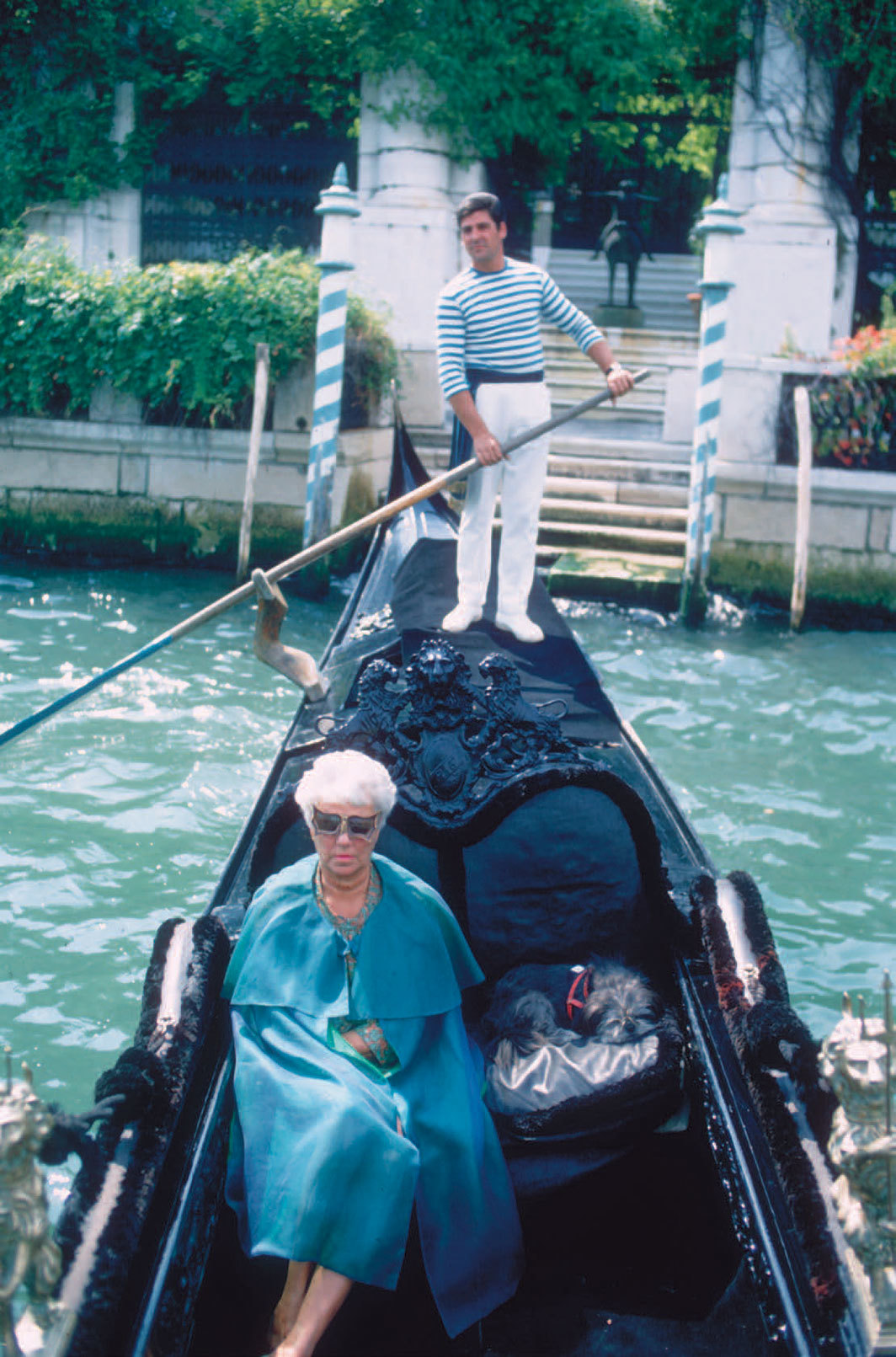 *Peggy Guggenheim outside the Peggy Guggenheim Collection, Venice, 1968.* Photo: Tony Vaccaro/Hulton Archive/Getty Images.