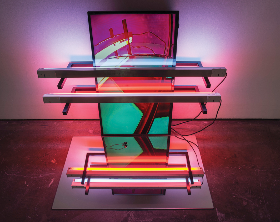 "Ross Manning, Bricks and Blocks, 2016, LCD TV, video camera, fluorescent lights, mirror, 37 1⁄8 × 48 × 35 1⁄2""."
