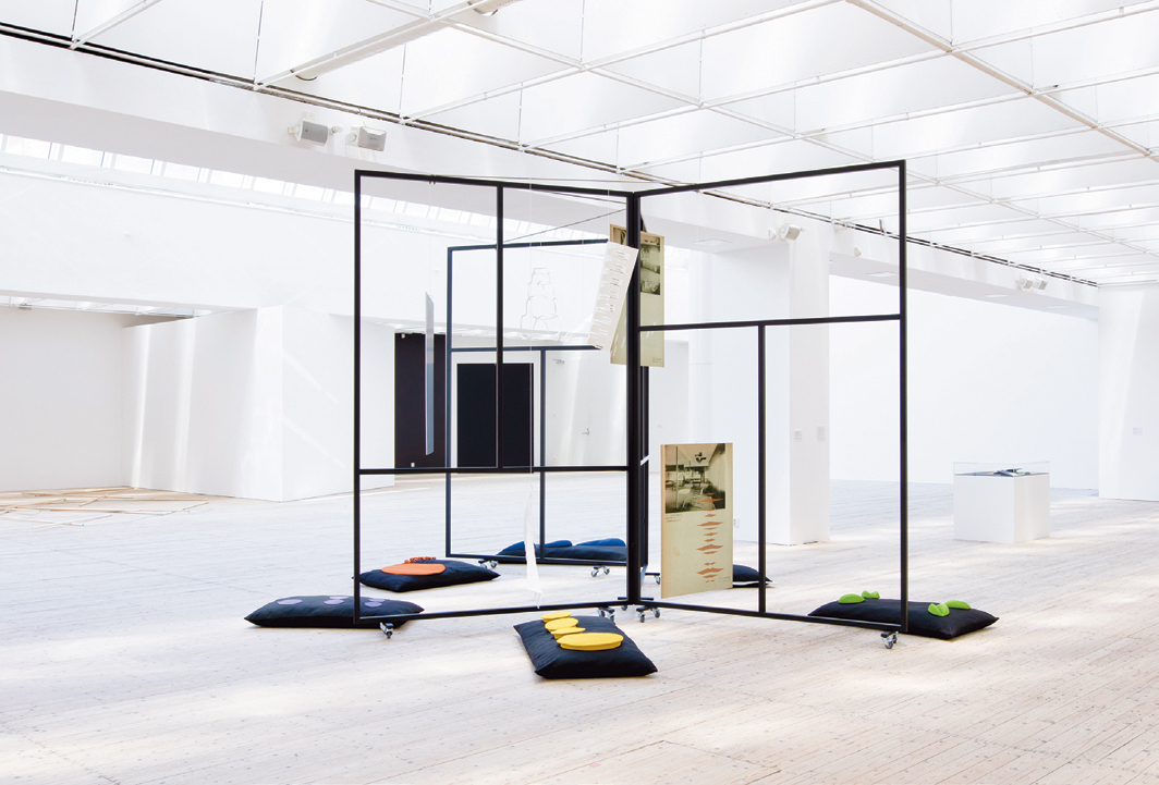 Luca Frei, Model for a Pedagogical Vehicle, 2018, powder-coated steel, fabric, digital prints on PVC, paper objects. Installation view, 2020.