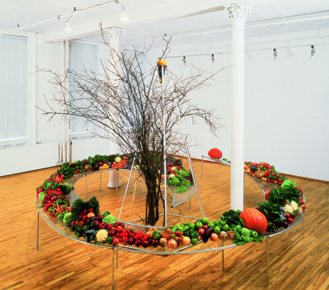 "Mario Merz, Tavola spirale (Spiral Table), 1982, aluminum, glass, fruit, vegetables, branches, steel, tar paper, beeswax, 10' 11 1/8"" × 18' × 18'. © Artists Rights Society (ARS), New York/SIAE, Rome."
