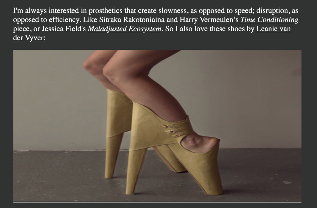 An image from the Abler archive features Leanie van der Vyver's high heels, made of pale yellow leather and worn by a white woman, designed with the supports reversed and the heel portion in front of the leg, forcing an atypical walking gait for the wearer and inverting the norms of fashionable shoes.