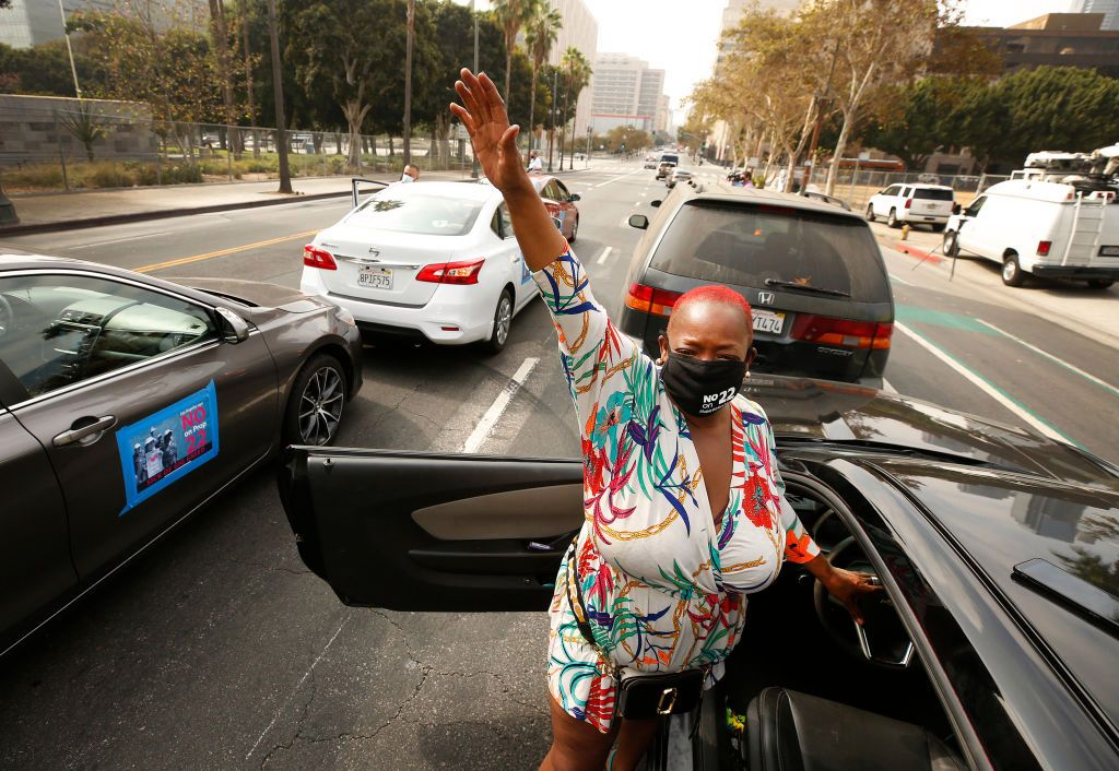 An app-based gig worker participates in an October 8 driving demonstration outside Los Angeles City Hall urging voters to vote no on Proposition 22. Photo: Al Seib/Getty.