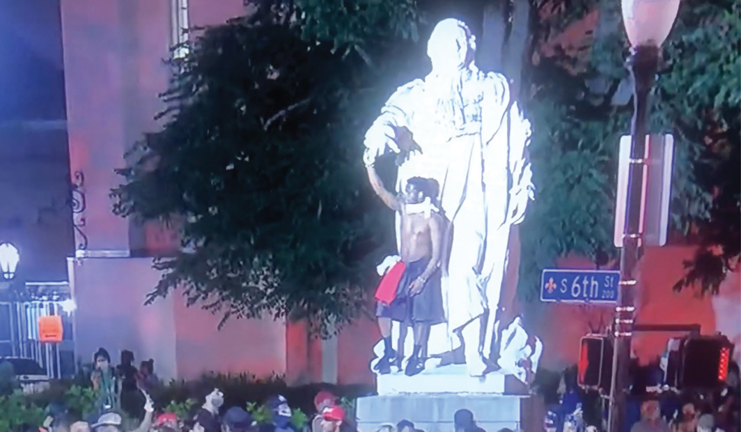 Protester breaking off the hand of a statue of Louis XVI, Louisville, KY, May 28, 2020. Photo: WDRB News.