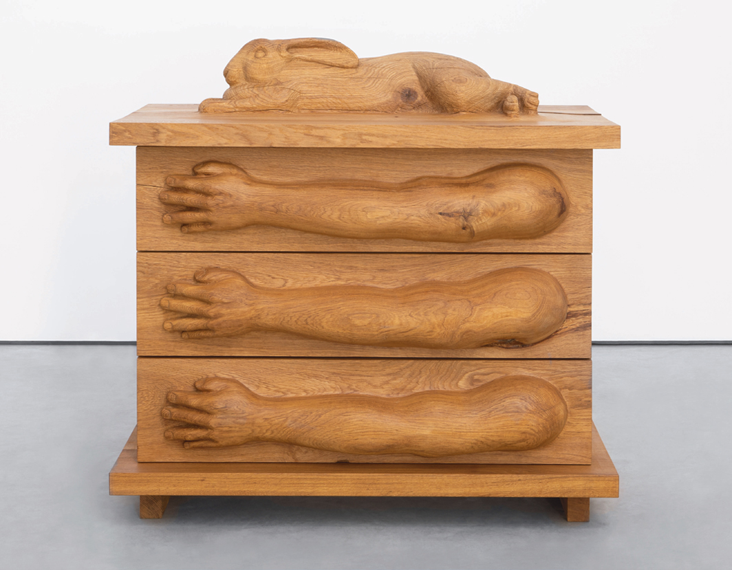 "Daniel Dewar & Grégory Gicquel, Oak chest of drawers with giant Flanders rabbit and arms, 2020, oak wood, 49 1/2 × 52 1/14 × 29 3/4""."