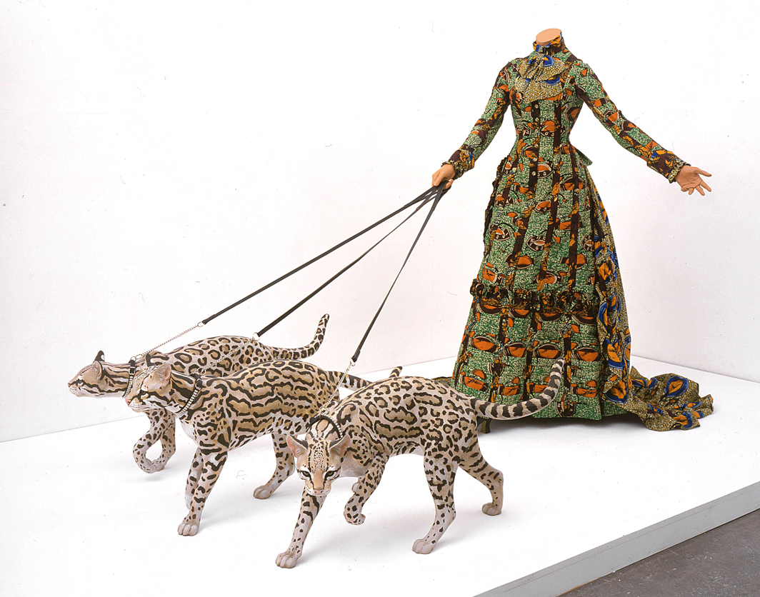 "Yinka Shonibare CBE, Leisure Lady (with Ocelots), 2001, Dutch wax-printed cotton textile, three fiberglass ocelots, fiberglass mannequin, leather, glass; mannequin: 63 × 31 1/2 × 31 1/2"", ocelots: each 15 3/4 × 23 5/8 × 7 7/8""."