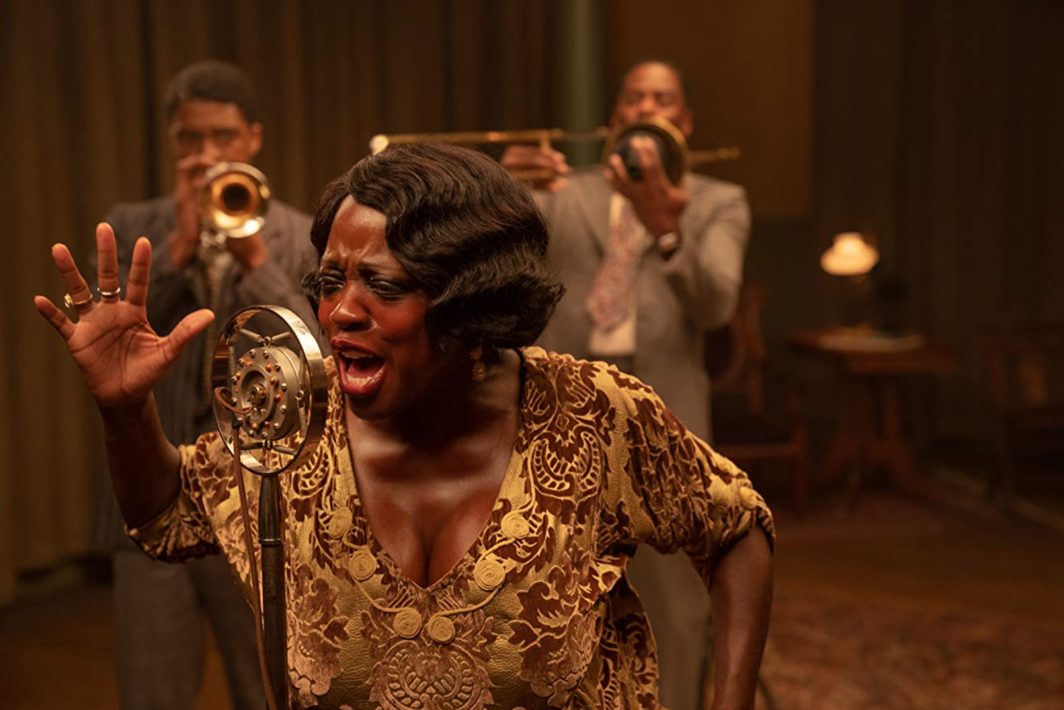 George C. Wolfe, Ma Rainey's Black Bottom, 2020, UHD video, color, sound, 94 minutes. Foreground: Ma Rainey (Viola Davis). Background: Levee (Chadwick Boseman) and Cutler (Colman Domingo).