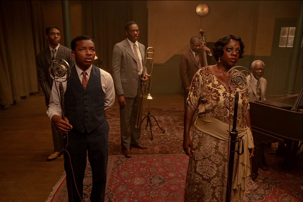 George C. Wolfe, Ma Rainey's Black Bottom, 2020, UHD video, color, sound, 94 minutes. Foreground: Sylvester (Dusan Brown) and Ma Rainey (Viola Davis). Background: Levee (Chadwick Boseman), Cutler (Colman Domingo), Slow Drag (Michael Potts), and Toledo (Glynn Turman).