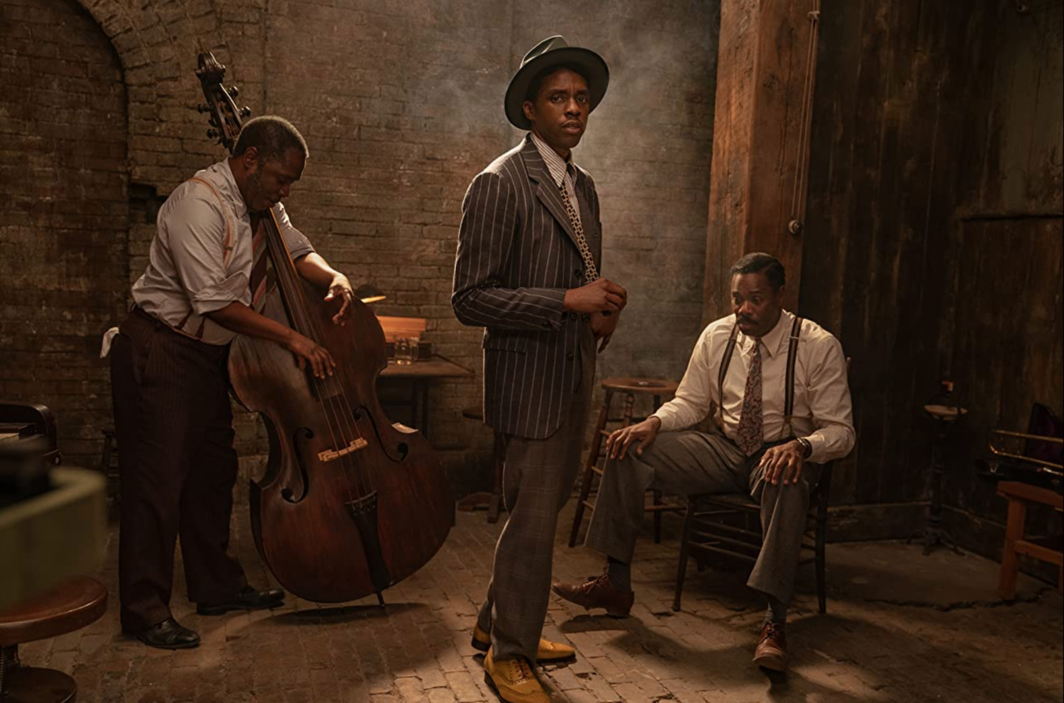 George C. Wolfe, Ma Rainey's Black Bottom, 2020, UHD video, color, sound, 94 minutes. Foreground: Levee (Chadwick Boseman). Background: Slow Drag (Michael Potts) and Cutler (Colman Domingo).