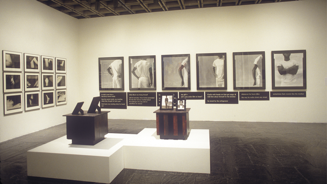 "View of ""Black Male: Representations of Masculinity in Contemporary American Art,"" 1994–95, Whitney Museum of American Art, New York. Floor: Kevin Everson, Mansfield, Ohio, End Table, 1994; Kevin Everson, Mansfield, Ohio, End Table, 1994. Wall, from left: Christian Walker, Miscegenation Series, 1985–88; Lorna Simpson, Gestures/Reenactments, 1985. Photo: Geoffrey Clements."