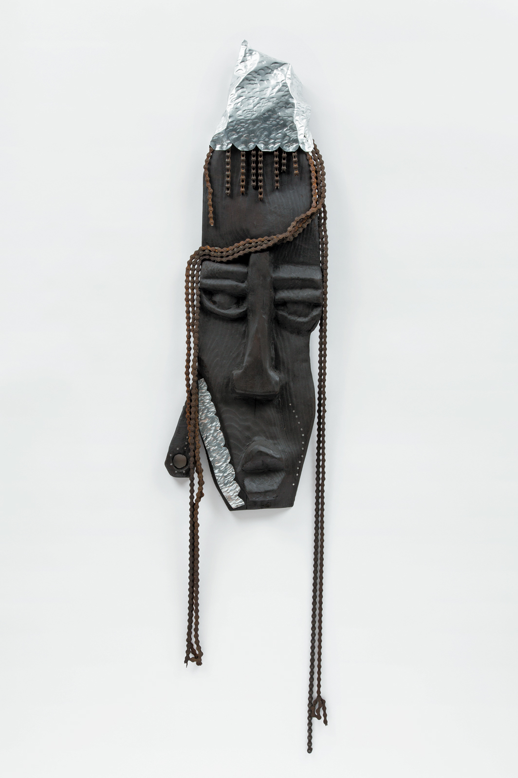 "Leilah Babirye, Nantege O'we Ngabi from the Kuchu Civet Cat Clan, 2020, wood, wax, aluminum, nails, found objects, 51 × 15 × 3""."