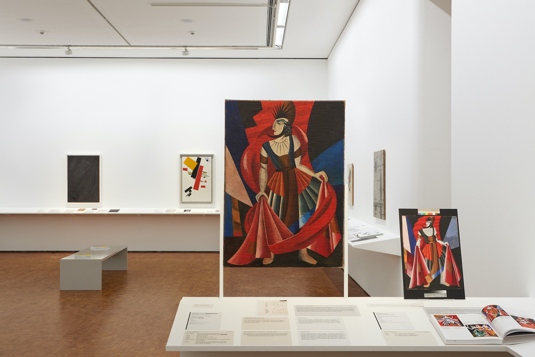 "View of ""Russian Avant-Garde at the Museum Ludwig: Original and Fake,"" 2020–21. Two works attributed as Alexandra Exter's Kostümentwurf ""Herodes,"" 1921 and 1917 respectively."