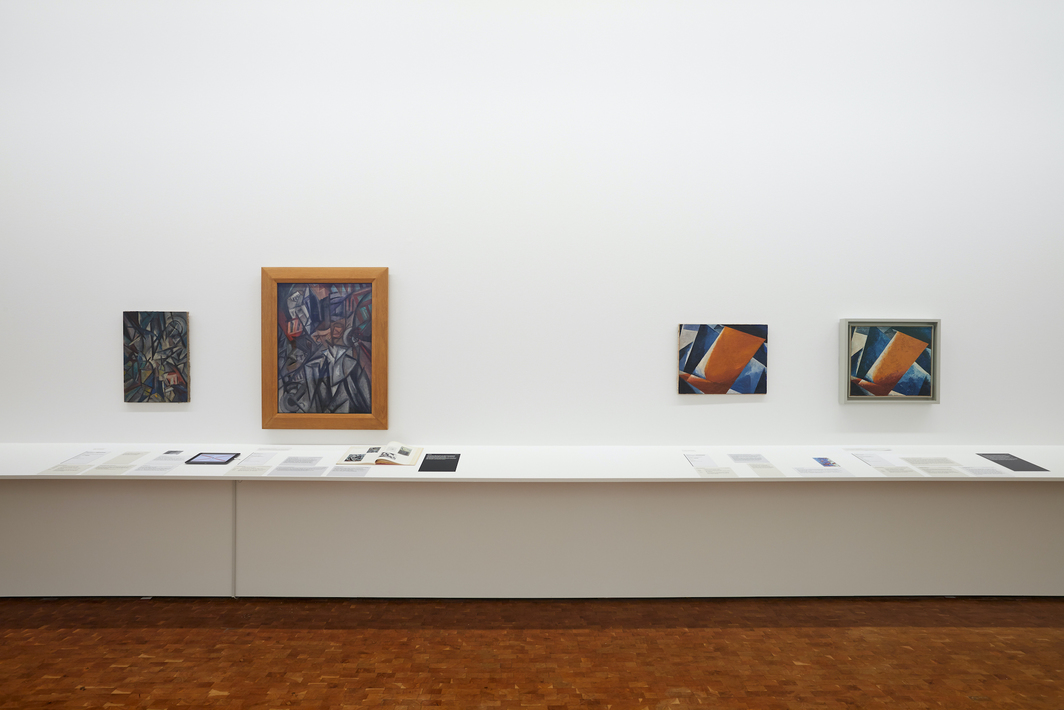"""View of the """"Russian Avant-garde at the Ludwig Museum: Original and Fake,"""" 2020–21.  Left: two canvases attributed to Olga Rozanowa, 1913. Right: two canvases attributed as Ljubow Popowa's Painterly Architectonic, 1920 and 1918 respectively."""
