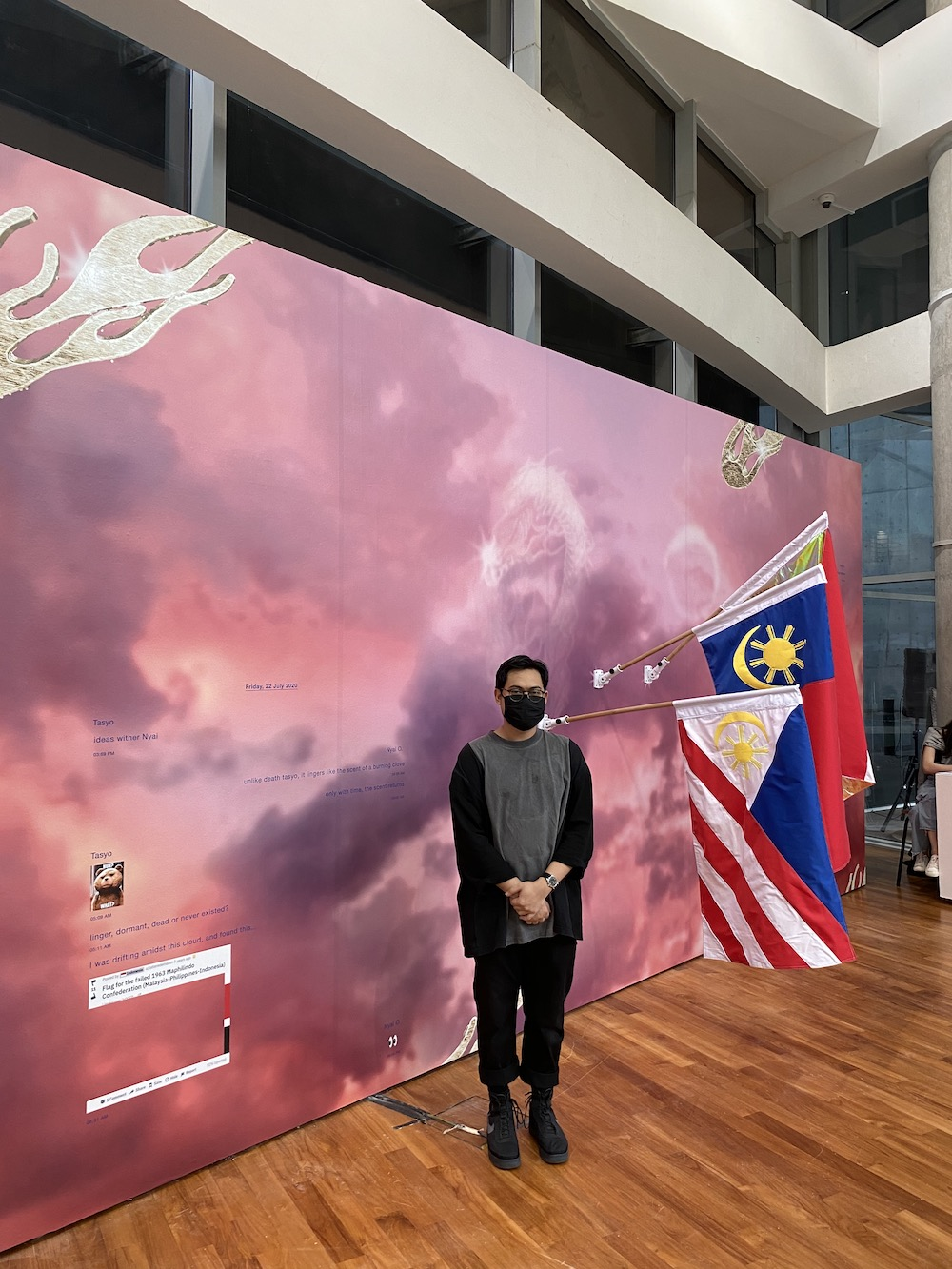 "Artist Fyerool Darma with his work for ""In Our Best Interests: Afro-Southeast Asian Affinities during a Cold War,"" ADM Gallery."