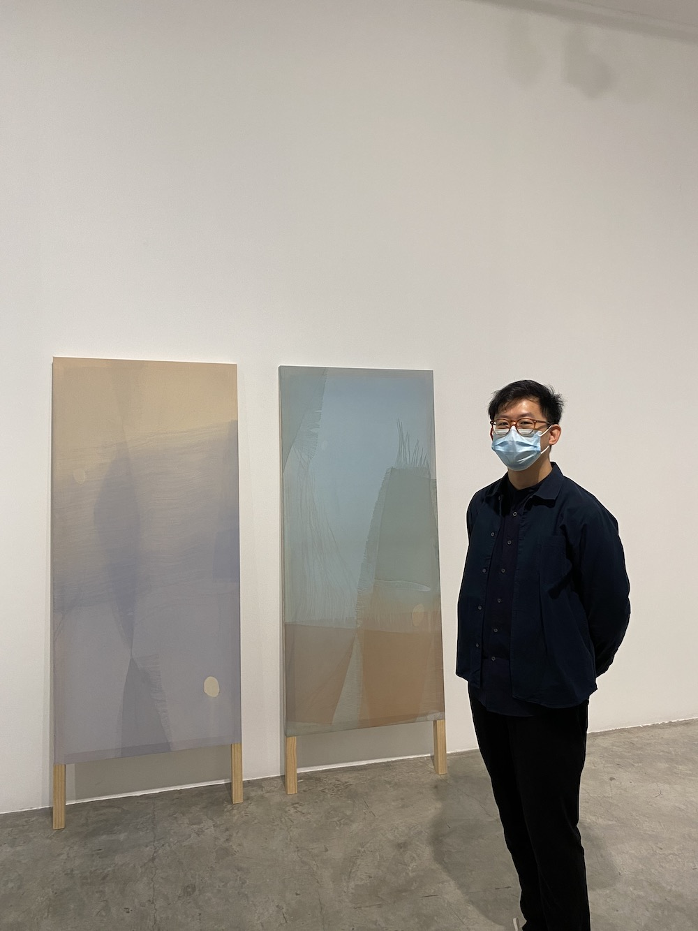 "Artist Guo-Liang Tan with his work in ""Strange Forms of Life,"" a show he curated at STPI Gallery."