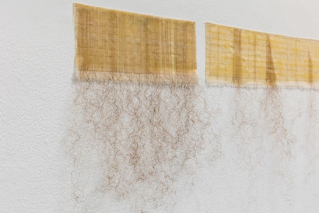 Afra Al Dhaheri, One at a Time (To Detangle Series), 2020, hair on cotton fabric, 78 3/4 x 13 3/4''.