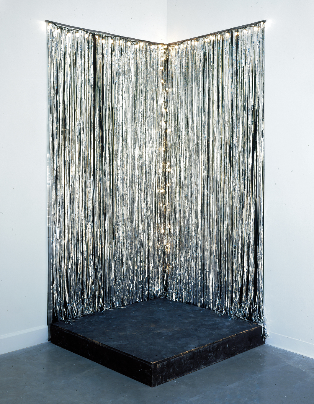 "Jack Pierson, Silver Jackie, 1991, plywood, silver Mylar, Christmas lights, 96 × 48 1⁄4 × 48""."