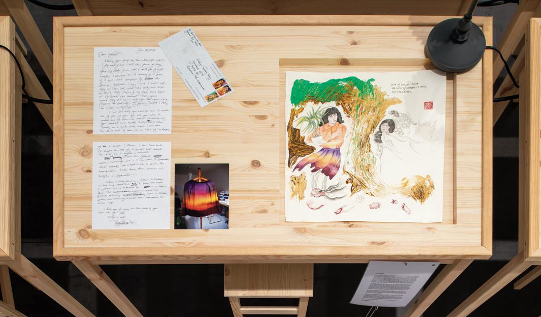 Evelyn Taocheng Wang, Spreading Elegance (detail), 2019, watercolor, acrylic, and ink on rice paper, envelopes, ink on paper, twenty wooden tables, twenty desk lights, twenty stools, Plexiglas, dimensions variable.