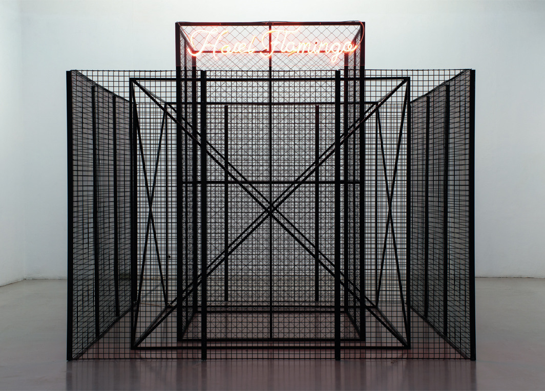 Kiluanji Kia Henda, Melilla Fence—Module IV (Hotel Flamingo), 2019, three square metal fences, neon sign. Installation view. Photo: Teresa Santos.