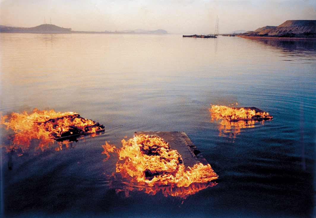 "Lee Seung Taek, Untitled (Burning Canvases Floating on the River), ca. 1988, C-print, 32 1⁄8 × 45 5⁄8""."