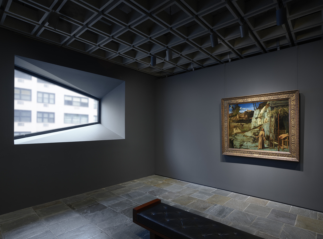 View of the Frick Madison featuring Giovanni Bellini's St. Francis in the Desert, ca. 1476–78, with a trapezoidal window conceived by Marcel Breuer. Photo: Joe Coscia.