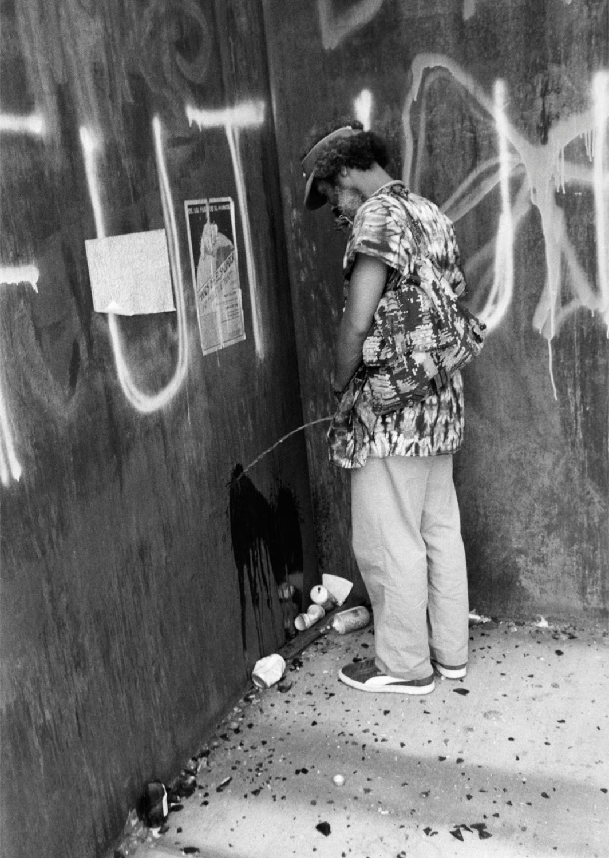 David Hammons, Pissed Off, 1981. Performance view, Richard Serra's T.W.U., 1980, Franklin Street and West Broadway, New York, 1981. Photo: Dawoud Bey.