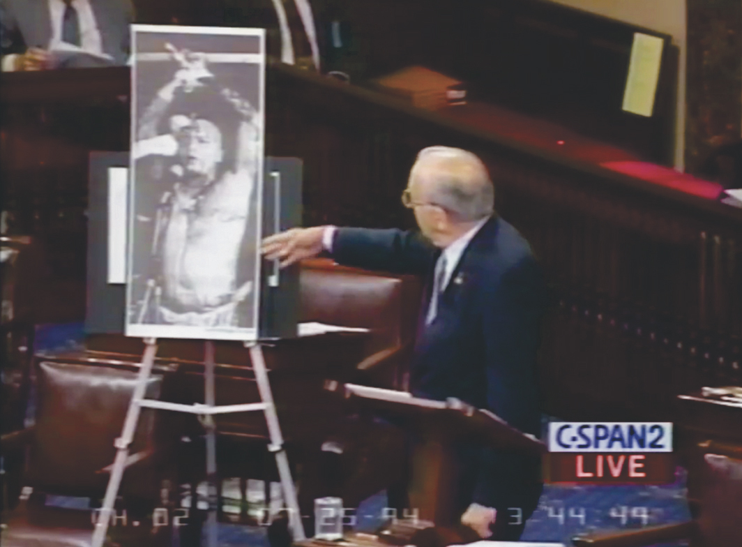 Video still of Jesse Helms excoriating Ron Athey (as Saint Sebastian in his Martyrs & Saints, 1992) on the floor of the US Senate, July 25, 1994.