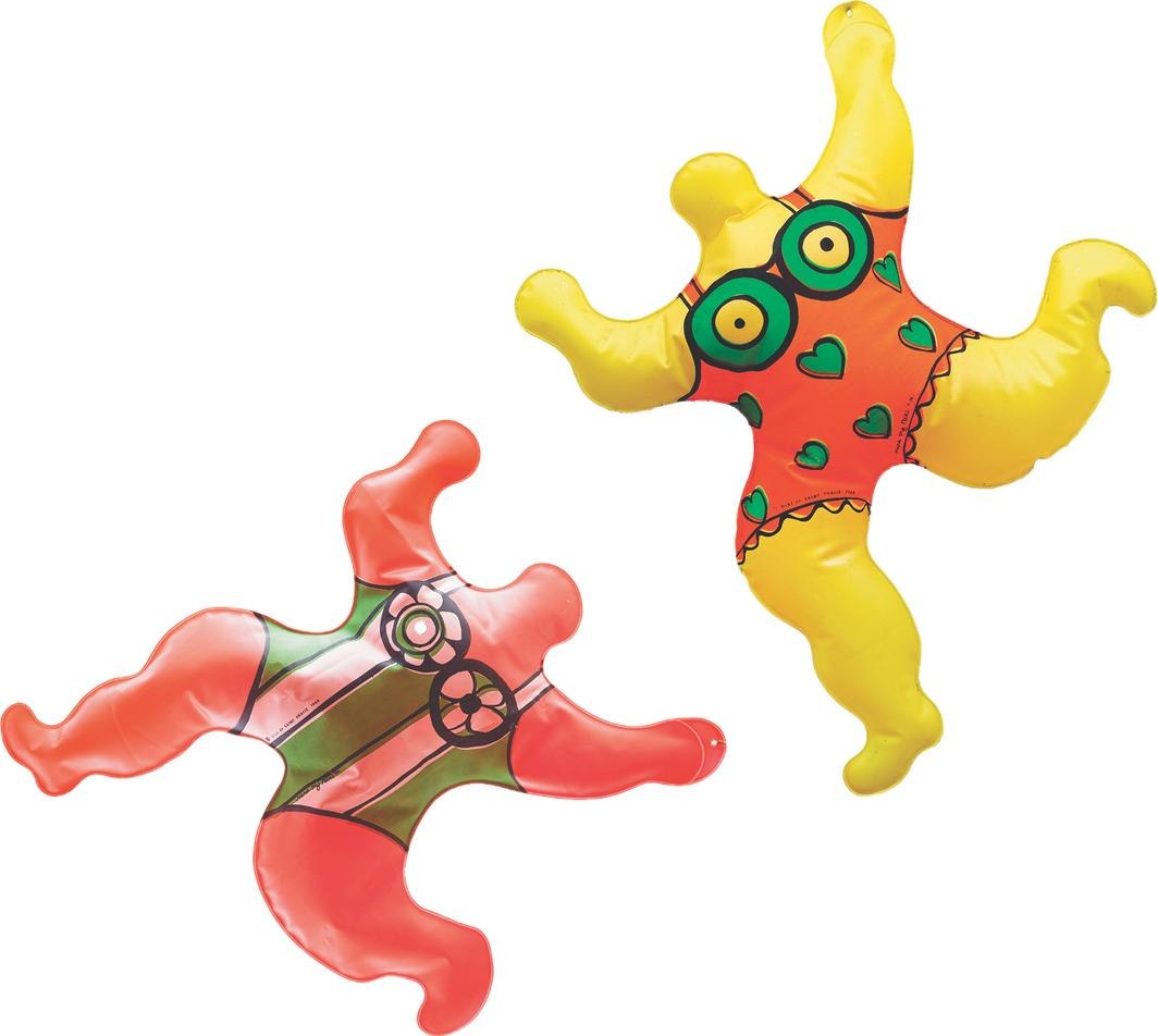 Two of Niki de Saint Phalle's inflatable Nana beach toys, 1968.