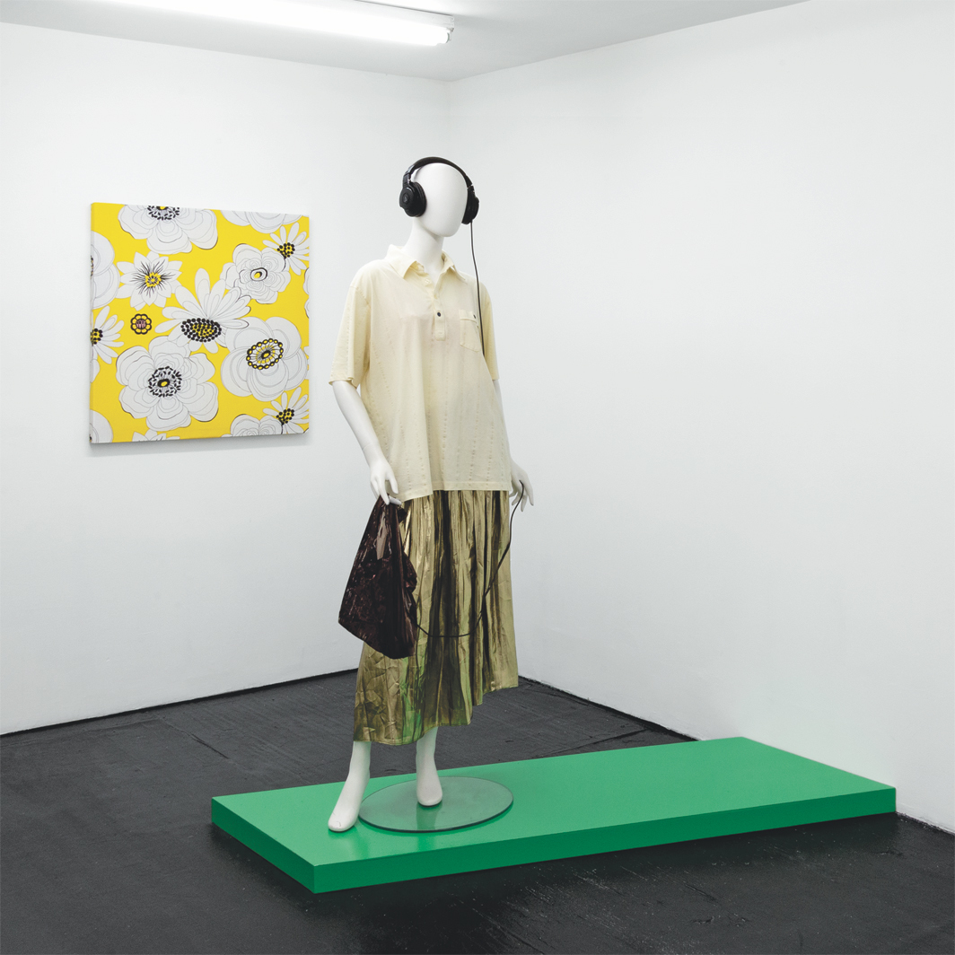 """View of """"Whitney Claflin: ADD SHOT,"""" 2020–21, Bodega, New York. Wall: LOVE (!!!), 2020. Floor: Mime in a Merry-Go-Round, 2020."""