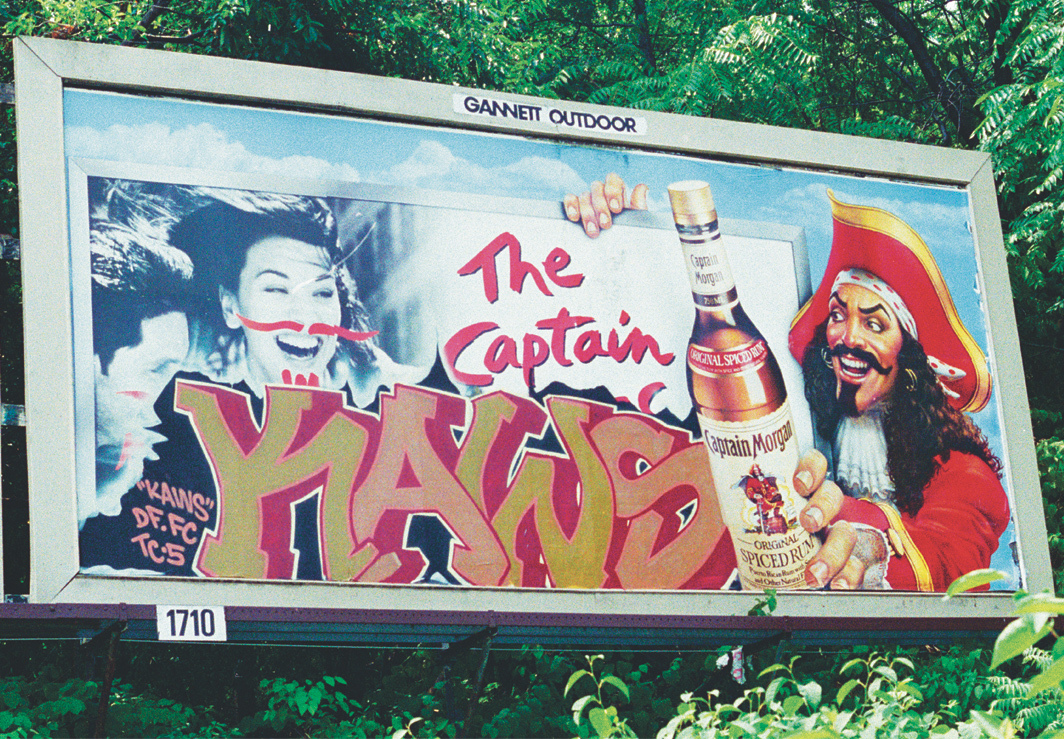 KAWS, Untitled (Captain Morgan), 1995, spray paint on billboard. Installation view, Jersey City, New Jersey.