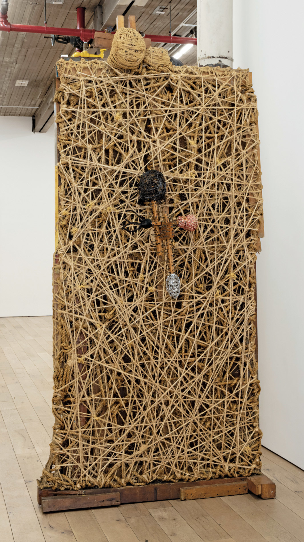 "Arthur Simms, Ego Sum, Portrait of Arthur Simms as a Junk Collector, 1994, mixed media, 115 × 56 × 50"". From ""Lost & Found."""