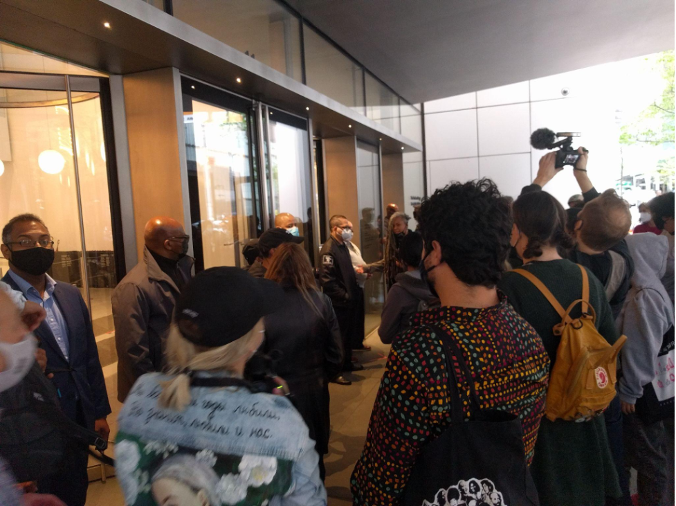Protestors are stopped by MoMA security.