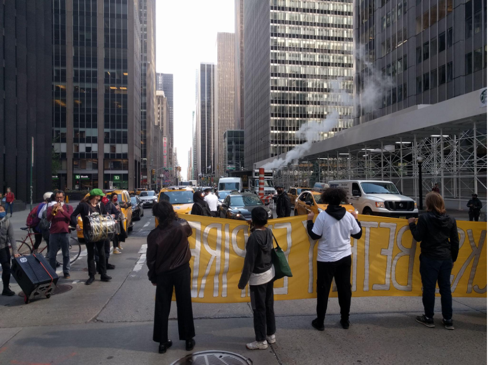 Protestors temporarily blocking the intersection at 53rd & 6th Ave.