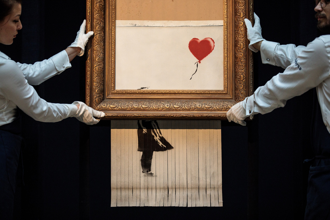 Banksy, Love Is in the Bin, 2018, aerosol paint, acrylic paint, canvas, board, 40 x 31 x 7''. Photo: Jack Taylor/Getty Images.