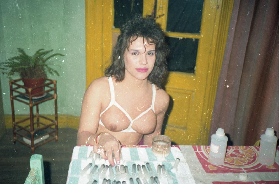 "Alejandra ""La Ñoño"" with homemade silicone applicators, San Telmo, Buenos Aires, ca. 1993."