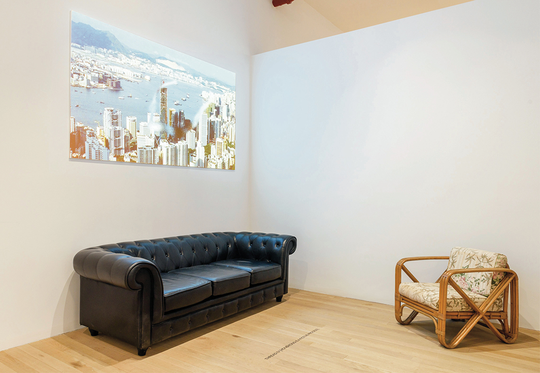 Tiffany Sia, Hong Kong Is a Fictive Process, 2021, video projection (color GIF), screen, sofa, chair. Installation view, Artists Space, New York. Photo: Filip Wolak.