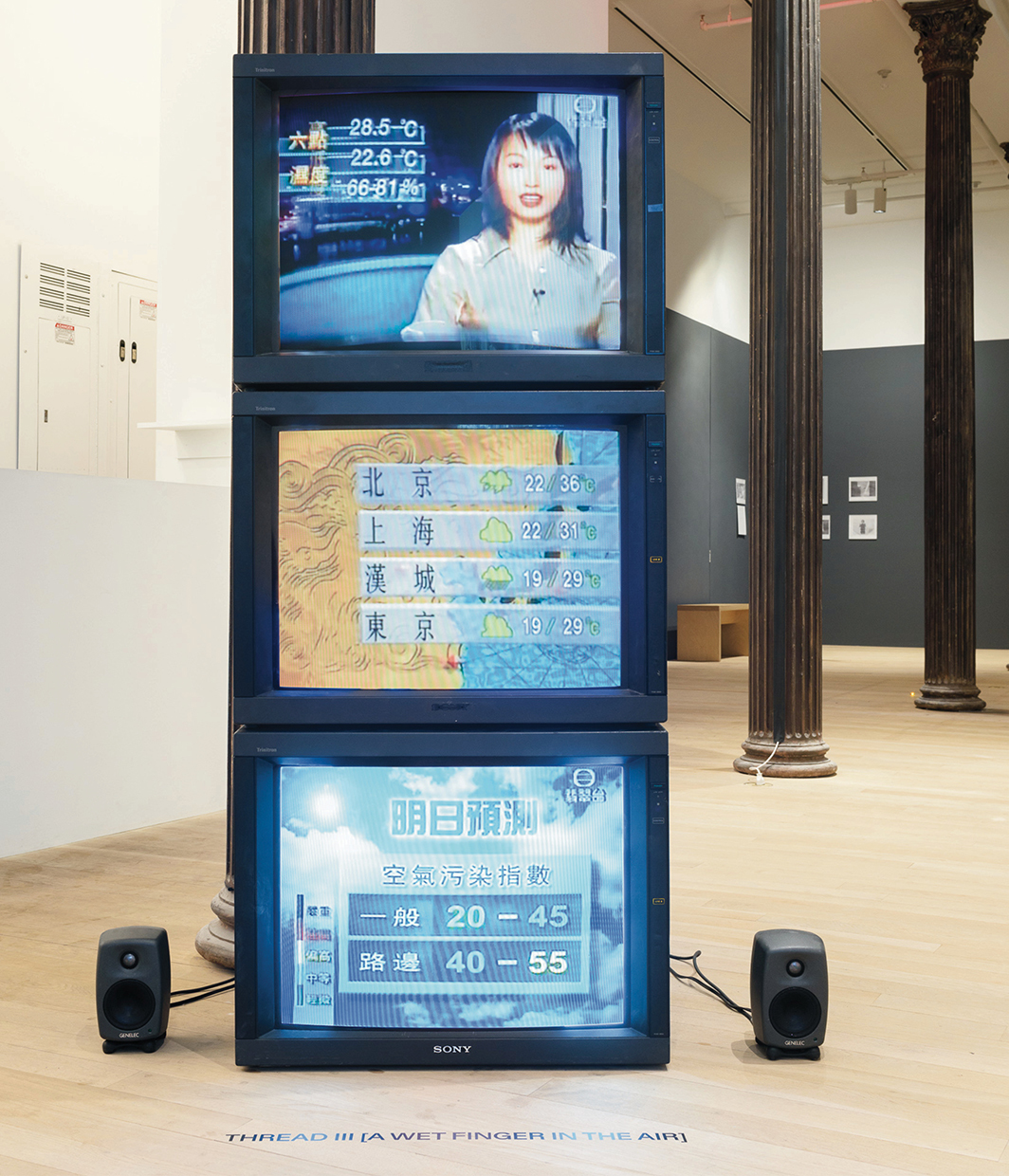Tiffany Sia, A Wet Finger in the Air, 2021, three-channel video (color, sound, infinite duration), monitors. Installation view, Artists Space, New York. Photo: Filip Wolak.