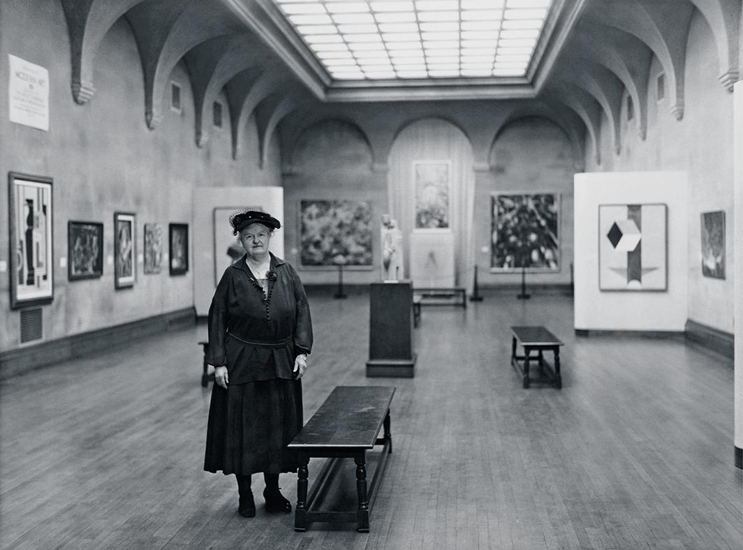 "Katherine Dreier at the exhibition ""Modern Art—Société Anonyme Painting,"" Yale University Art Gallery, New Haven, 1942. Photo: Yale University Library."