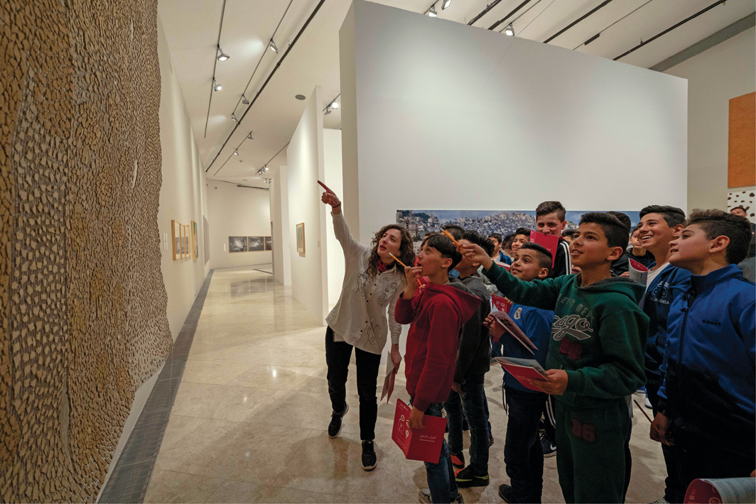 """A school tour of """"Intimate Terrains: Representations of a Disappearing Landscape,"""" Palestinian Museum, Birzeit, April 6, 2019. Photo: Hareth Yousef."""