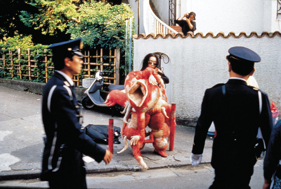 Lee Bul, Sorry for Suffering—You think I'm a puppy on a picnic?, 1990. Performance view, Tokyo, 1990. Lee Bul.