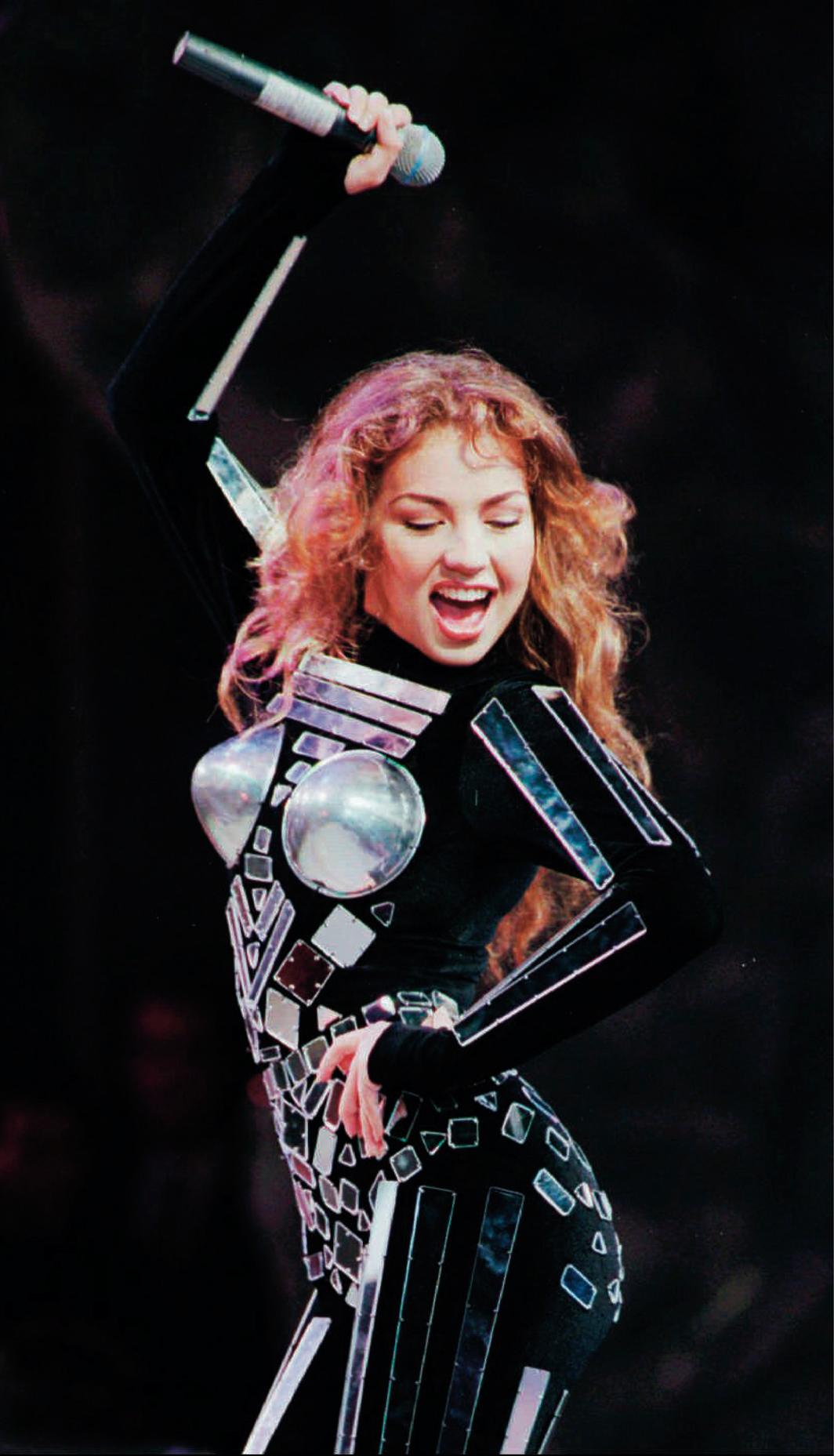 *Thalía performing at Araneta Coliseum, Quezon City, Philippines, August 21, 1996.Photo: Pat Roque/AP/Shutterstock. Pat Roque/AP/Shutterstock.