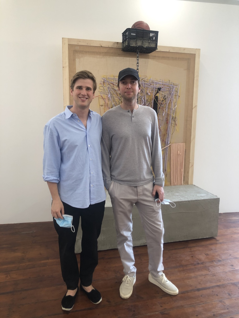 Leopold Thun of Emalin Gallery and designer Gabriel Chipperfield in front of Alvaro Barrington's Street dreams are made of basketball.
