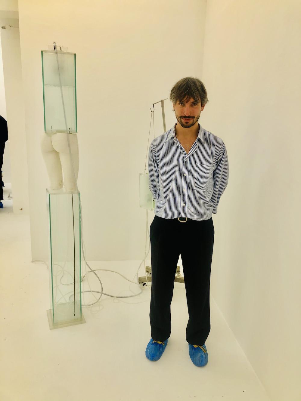 Oswaldo Nicoletti of Nicoletti gallery with work by Hugo Servanin.