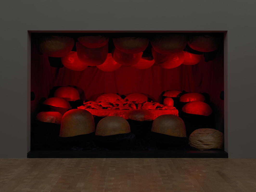 """Louise Bourgeois, The Destruction of the Father, 1974, latex, plaster, wood, fabric, and red light, 7' 9 5/8"""" x 11' 10 5/8"""" x 8' 1 7/8"""