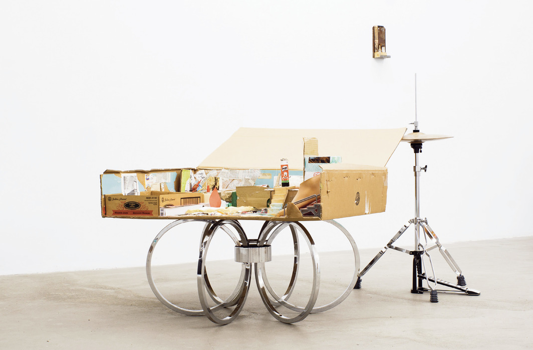Georgia Dickie, Maquette for Dream Home, 2021, cardboard box, found objects, glue, hi-hat cymbals and stand, found metal base, dimensions variable.